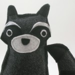 Raccoon Plush. Close up of their face.
