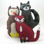 woodland friends plush include a fox, owl, and raccoon.