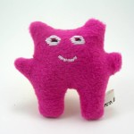 a soft pink monster plush toy
