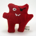 Wee red corudroy pirate monster plush.