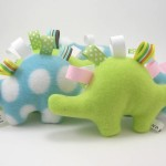 Baby tag toy. In green and blue with multi colored tags. Soft fleece for vegan babies